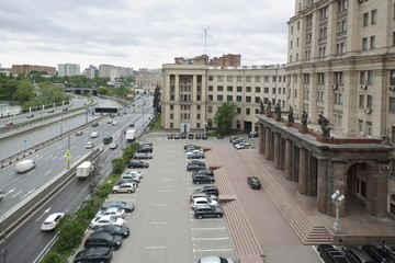 Cityscape with old building of the Moscow State Technical University by Bauman and embankment.