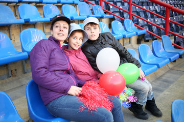 Portrait of a mother with daughter and son in an empty sports stadium