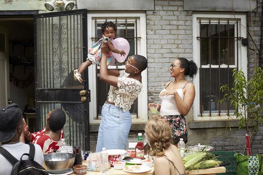 Family enjoying backyard barbecue