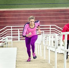 Athlete running up bleachers