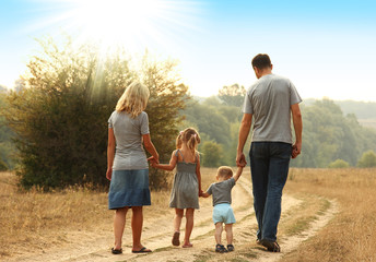 young family walk together