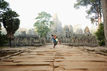 Couple visiting ancient temple, Angkor, Siem Reap, Cambodia