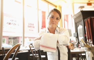 Caucasian waitress sitting in restaurant