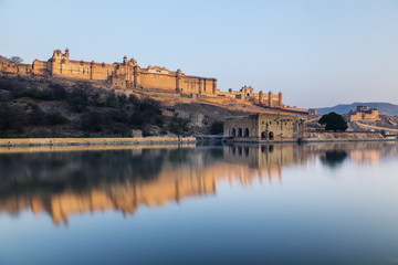 Amber Fort reflecting in still river under blue sky, Jaipur, Rajashan, India