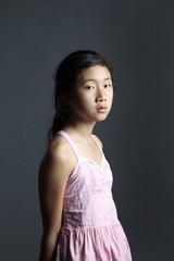 Portrait of Asian girl in pink dress