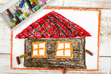 colorful drawing: a house with a red roof
