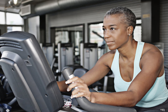 African American woman exercising in health club