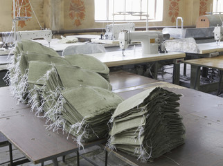 Stacked sacks in textile factory