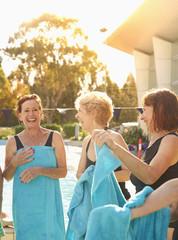 Older Caucasian women drying off at pool