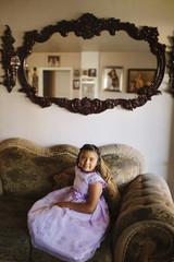 Hispanic girl sitting on living room sofa