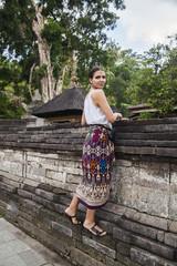 Woman climbing on stone wall