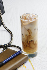 A glass of Coffee with milk and ice