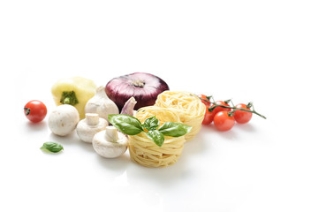 white pasta and fresh basil, mushrooms, cherry tomatoes, onions, peppers on a white background