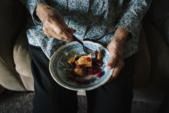 Close up of older mixed race woman eating