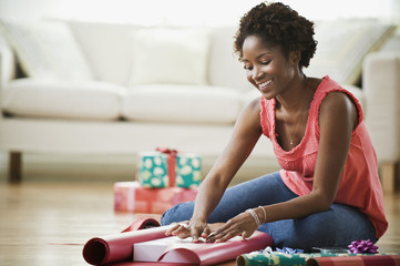 African woman wrapping presents