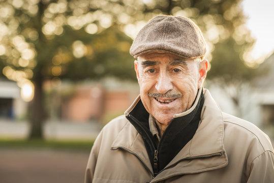 Older Hispanic man smiling outdoors