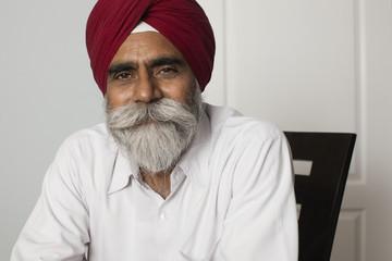 Senior Asian man with beard in turban