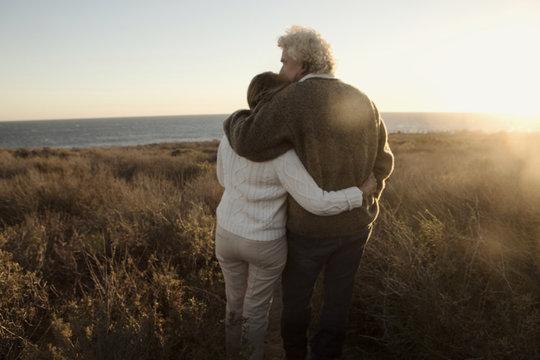 Older Caucasian couple looking at ocean view