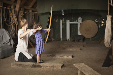 Children practicing archery with target