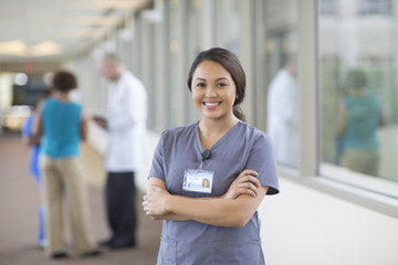 Nurse smiling in hallway