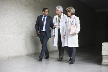 Businessman talking to doctors