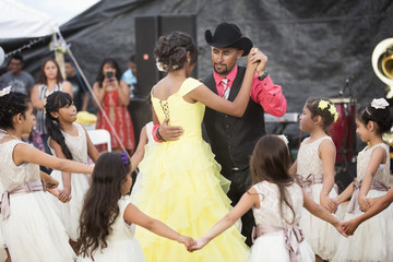 Hispanic community dancing at quinceanera