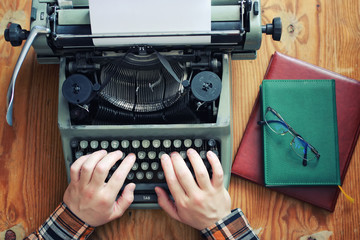 typewriter retro hand on wooden table
