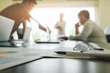 Team work concept,team meeting,man and woman working in the office. collaborative teamwork. Project managers meeting.business crew working with new startup.Analyze plans.selective focus,vintage color Wall mural