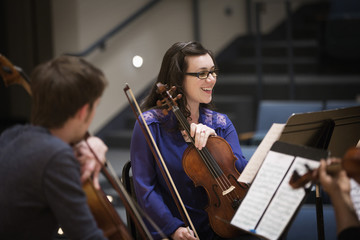 Student playing in college string quartet