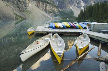 Canoes moored at lake dock