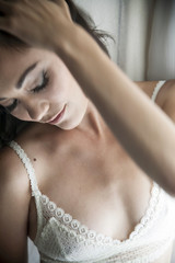 Close up of glamorous Caucasian woman in bra and makeup