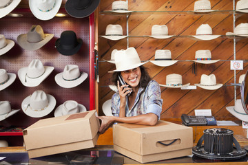 Ecuadorian woman working in hat store