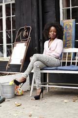 Black woman sitting on bench