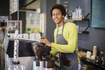Mixed race barista working in coffee shop