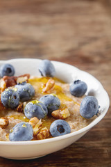 Perfect breakfast. Oatmeal blueberry walnut and honey. Healthy e