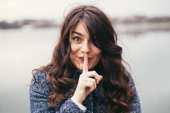 Beautiful woman keeping a secret