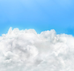 White clouds on clear blue sky. Beautiful sky background.