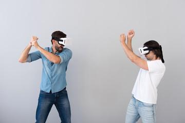 Serious involved men using virtual reality glasses