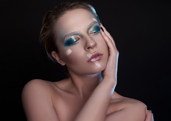 Winter woman portrait. Beautiful fashionable model with white short hair and blue eyes closeup. Creative make up.