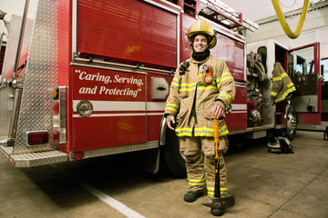 Hispanic fireman in coat and helmet