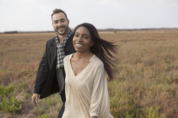 Couple walking in field