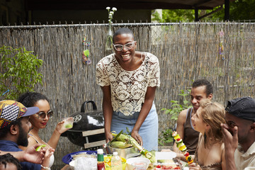 Friends enjoying backyard barbecue