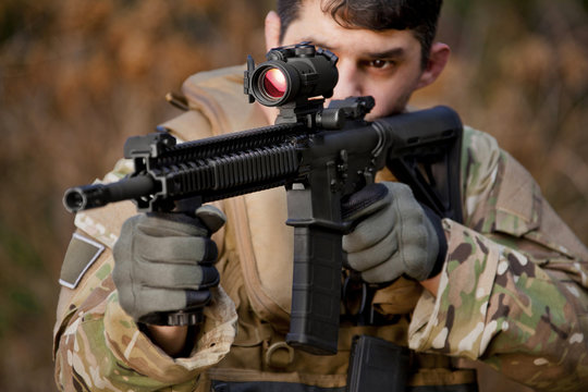 Soldier aiming automatic weapon during training