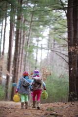 Caucasian girls walking in forest