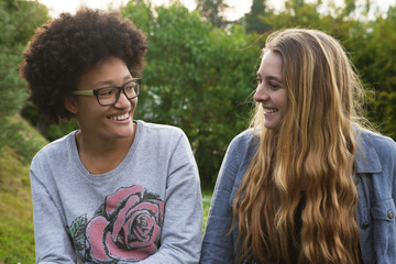 Teenage girls smiling in backyard