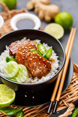 Asian food - meat with rice and vegetables.