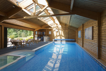 Indoor swimming pool under skylight
