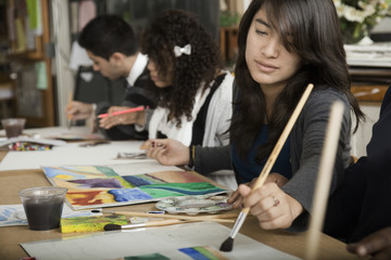Students painting in classroom
