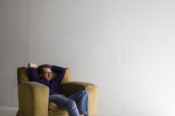 Caucasian man sitting in armchair