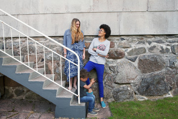 Teenagers and boy standing on steps